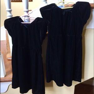 Two black velvet toddler dresses